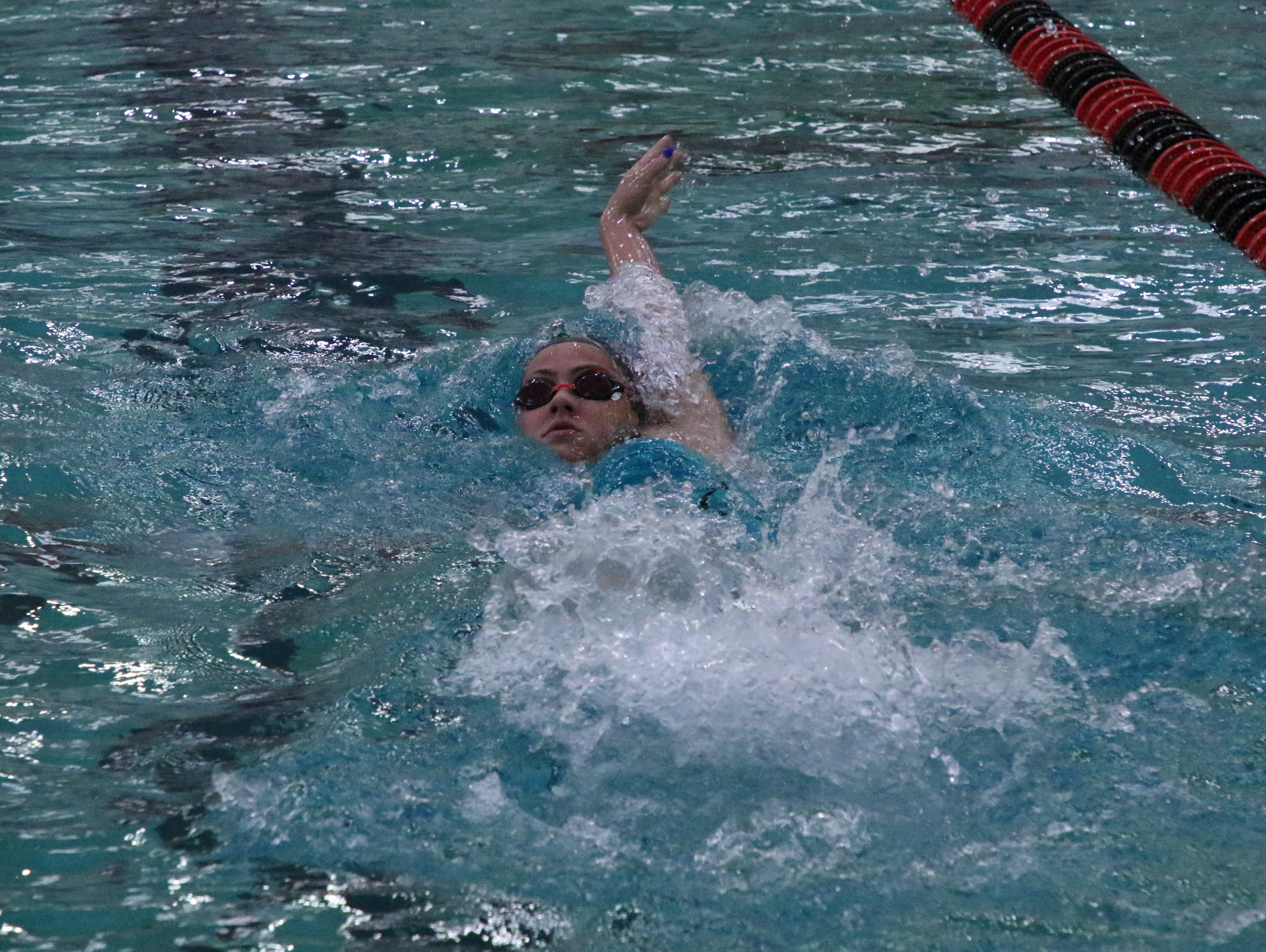 Las Cruces' Sarah Gormley swims the backstroke during her team's medley relay on Friday.