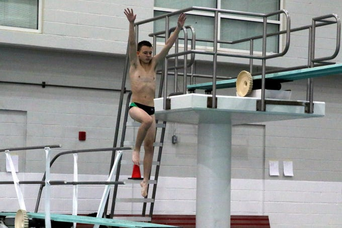 Farmington's Eddie Durphy starts one of his dives during Friday's portion of the 2019 NMAA State Swimming and Diving Championships at Albuquerque Academy. He is currently in fifth place with 255.80 points.