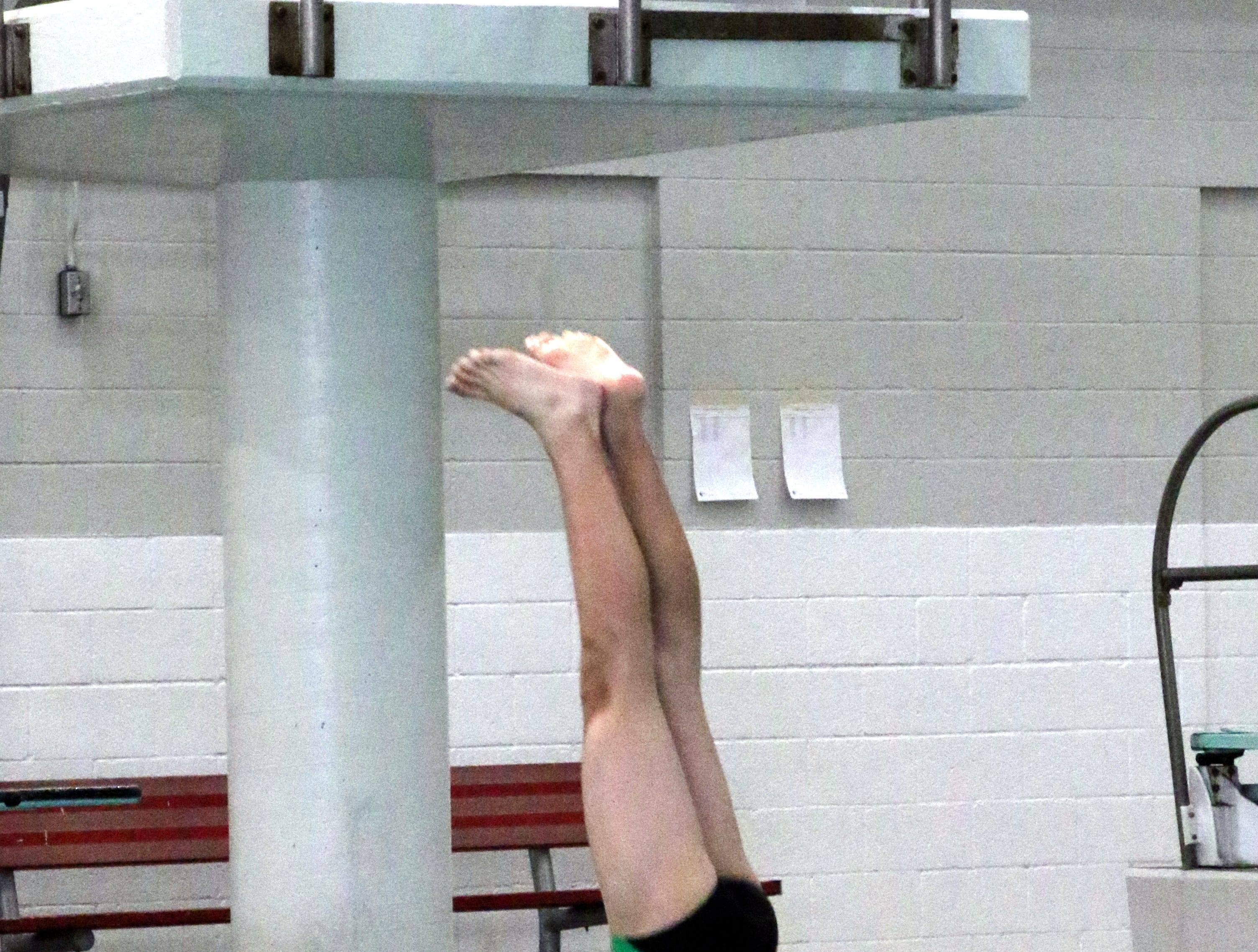 Farmington's Eddie Durphy hits the water during one of his eight dives on Friday.