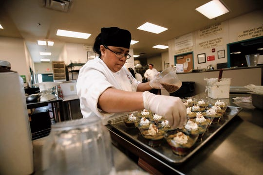 Culinary arts student Lorencita Billiman works on a parfait on Feb. 25, 2015 at Navajo Technical University in Crownpoint.