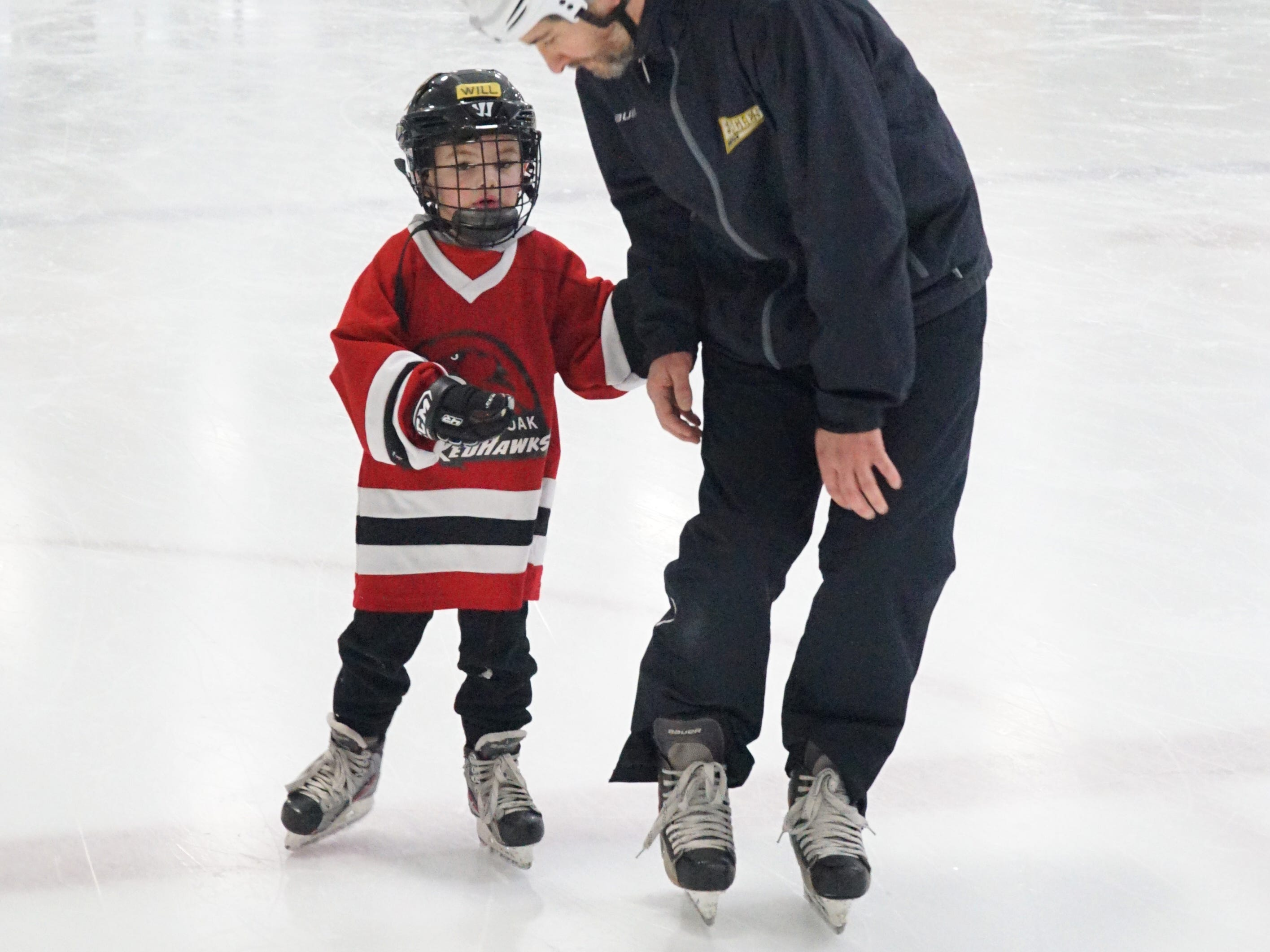 Dan Shrake talks to his son Will, 5, as the two skate around the Birmingham Ice Arena on Feb. 22.
