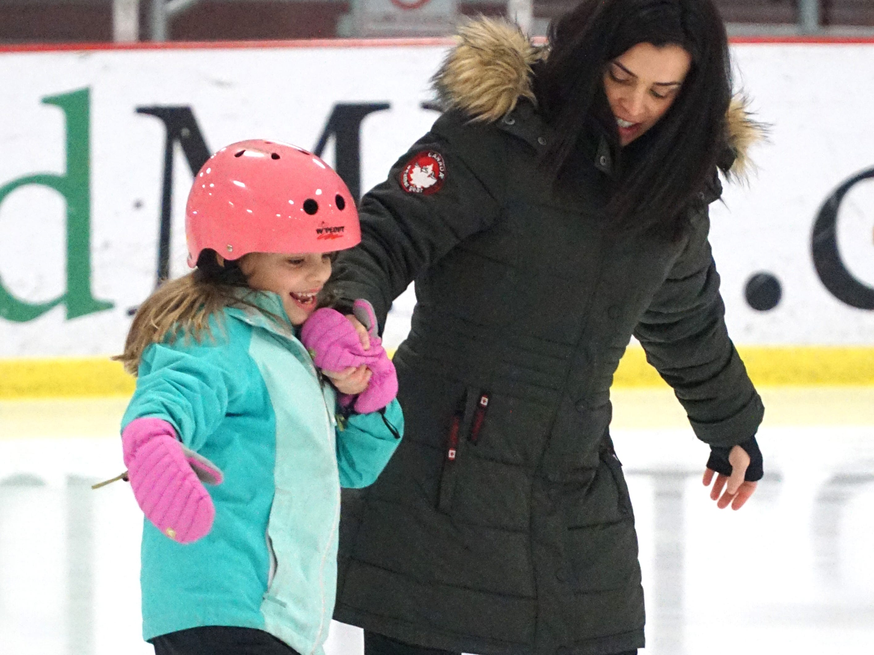 Kristin Sowle helps her daughter Lucy, 8, across the surface at the Birmingham Ice Arena on Feb. 22.
