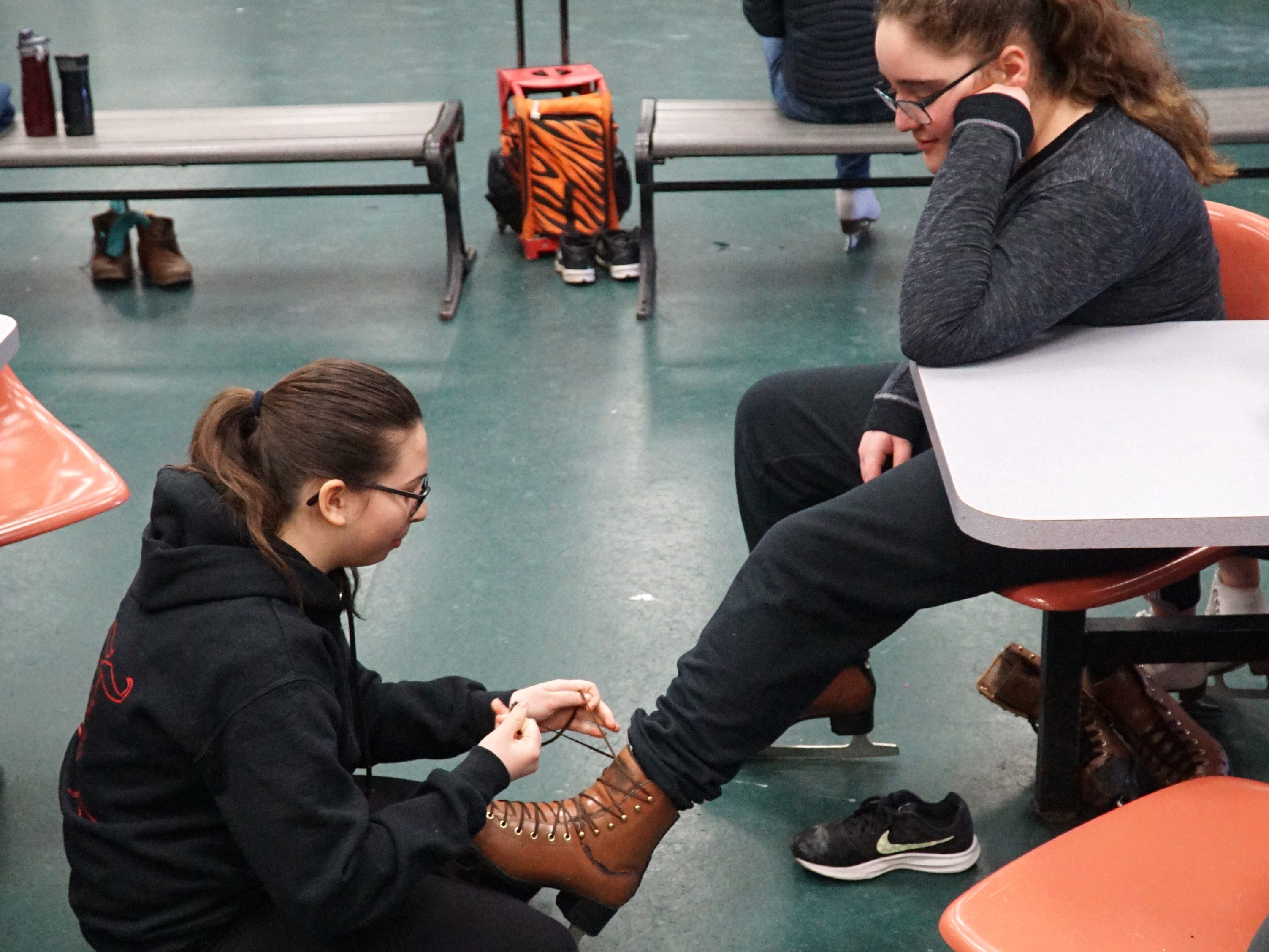Sasha Feller, 12, laces up the skates of friend Abbie Gelfund, 12, at the Feb. 22 Open Skate at the Birmingham Ice Arena. The arena has three open skates Weds-Fri from 1:10 to 2:30 with skates available for rental. The arena is located at 2300 E. Lincoln in Birmingham. For more information on availability of the ice, call 248-530-1640.
