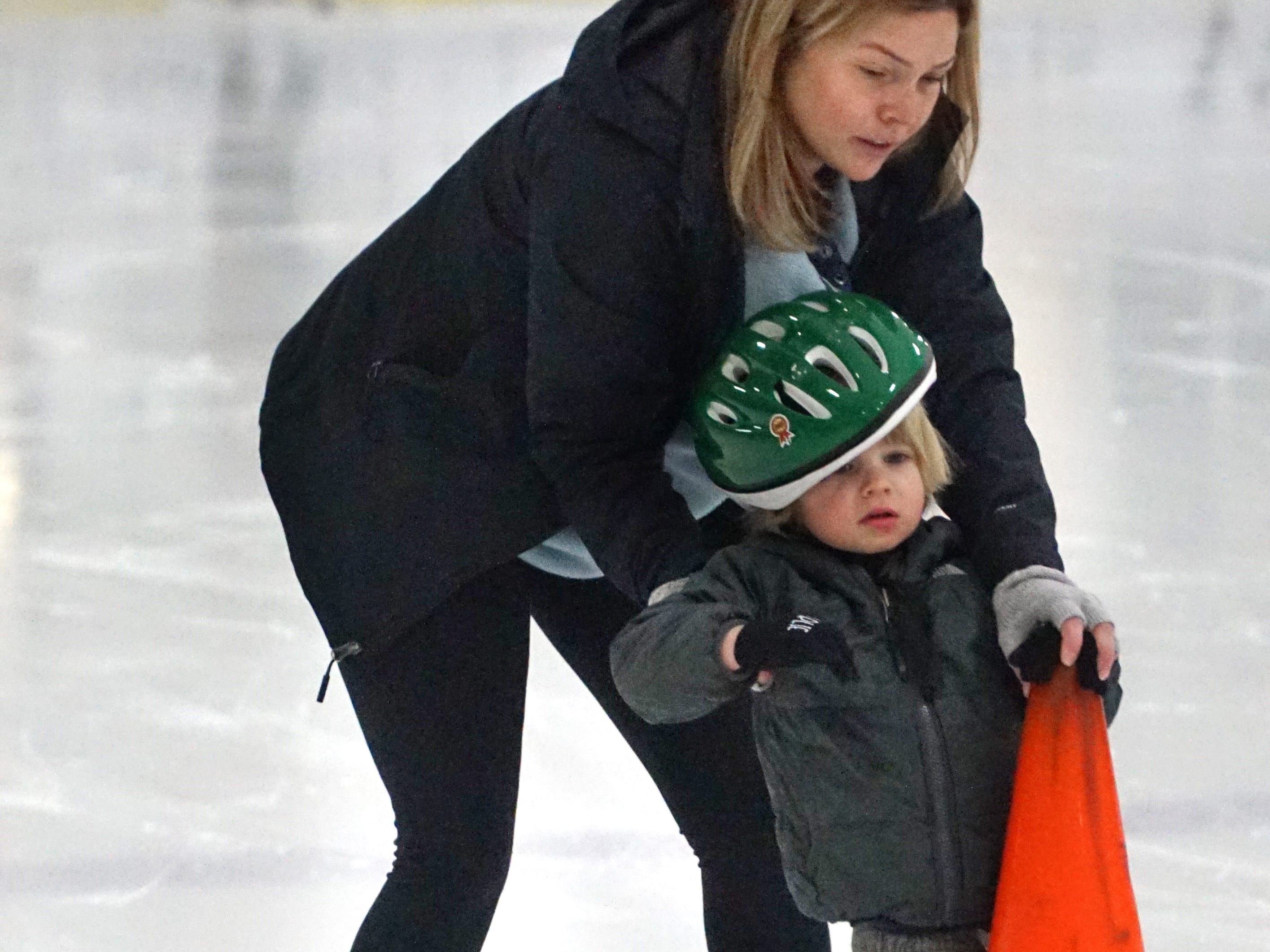 Stacey Marks helps her son Charlie, 3, around at the Birmingham Ice Arena on Feb. 22.