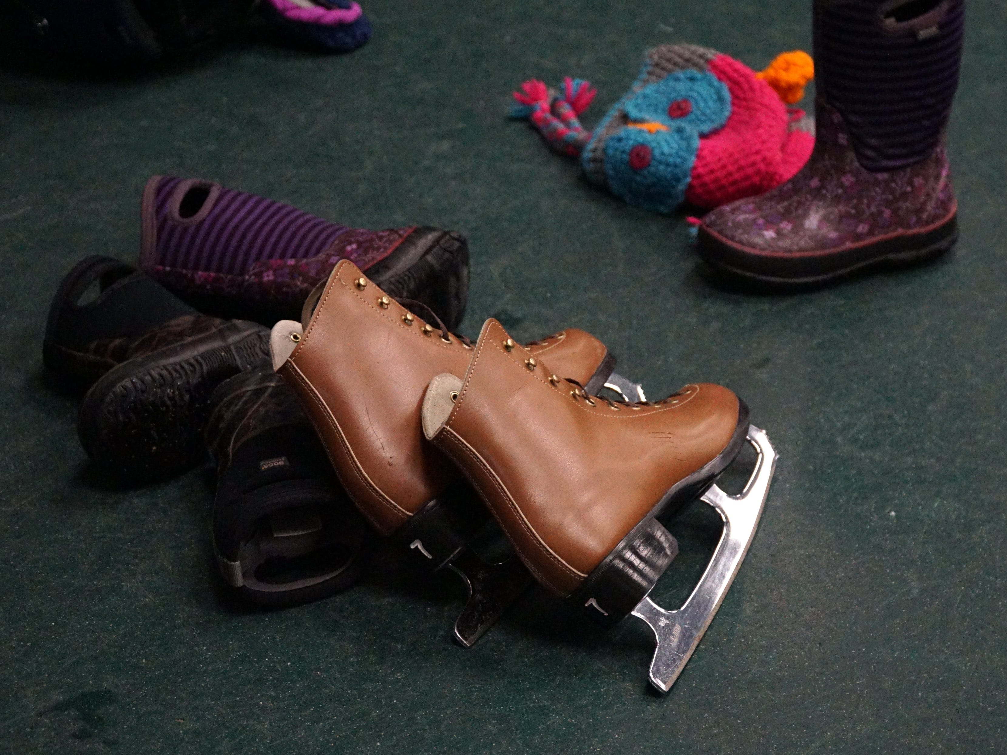 Ice skates and boots lie side-by-side at the Birmingham Ice Arena on Feb. 22 at the start of its Open Skate. The skate's been very popular as most school kids are out on mid-winter break.
