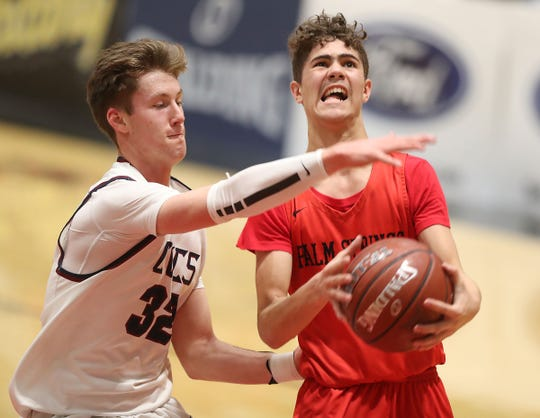Elijah Goad of Palm Springs is fouled by Luke Powell of Capistrano Valley Christian in the CIF Southern Section Championship, February 23, 2019.