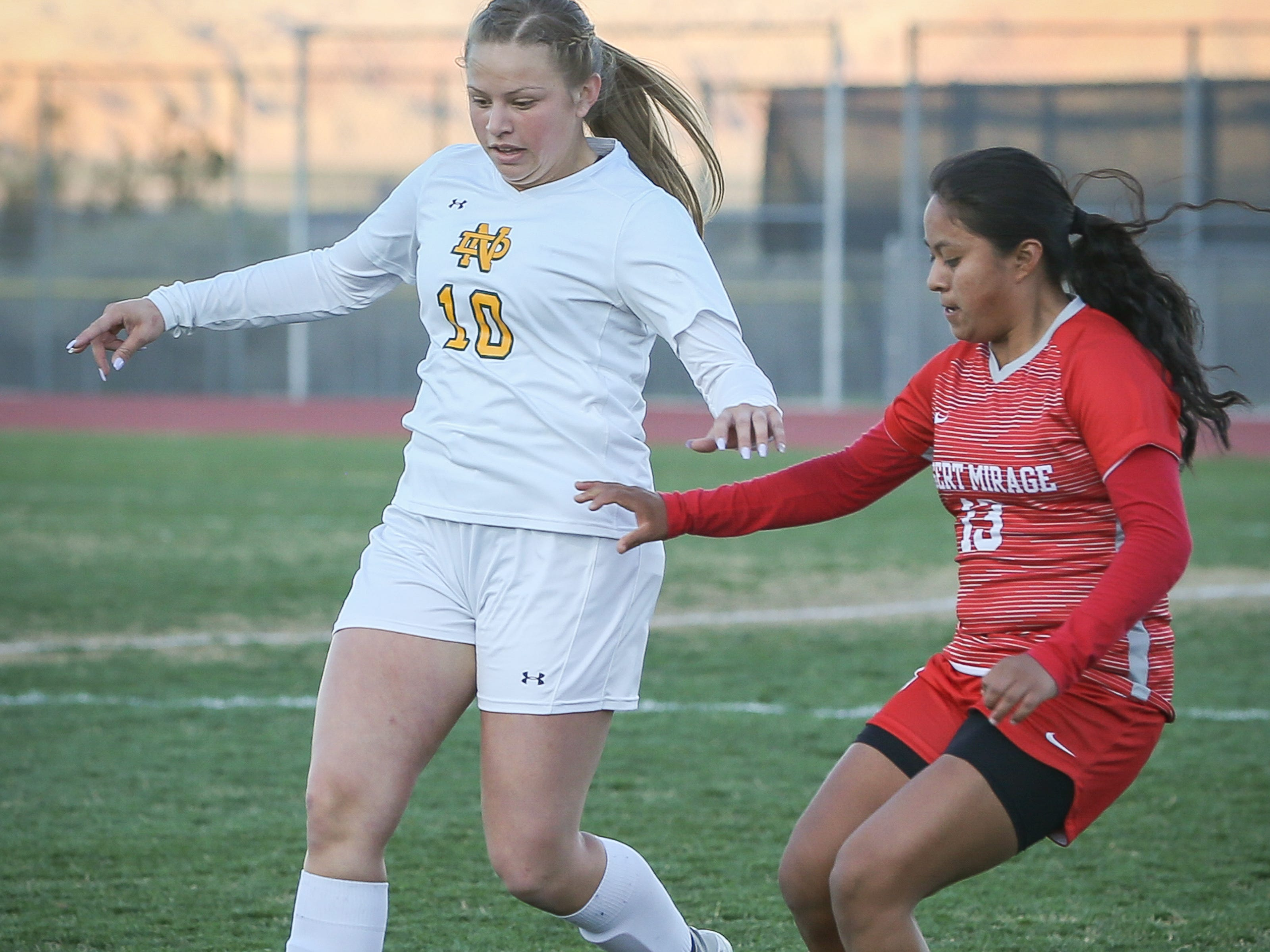 Maria Felipe (#13) goes against Notre Dame's Bailee Ulloa. The Desert Mirage varsity soccer team won its first girls' soccer CIF title 1-0 against Notre Dame in overtime.
