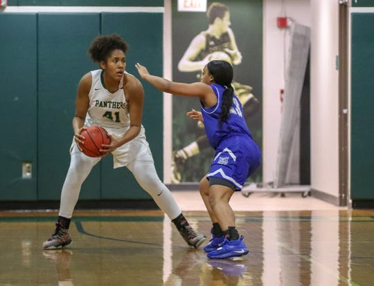 Booker T. Washington's Jaila Roberts defends Nease's Camille Hobby (No. 41) in the Region 1-7A finals on Friday at Nease.
