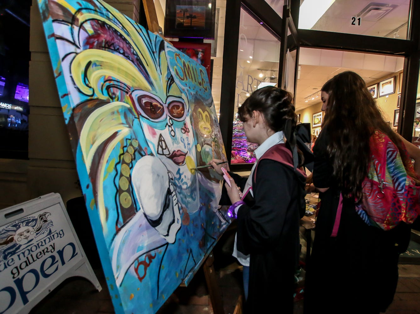 Claire Kennington, 10, paints outside of Blue Morning Gallery during Gallery Night on Friday, February 22, 2019.