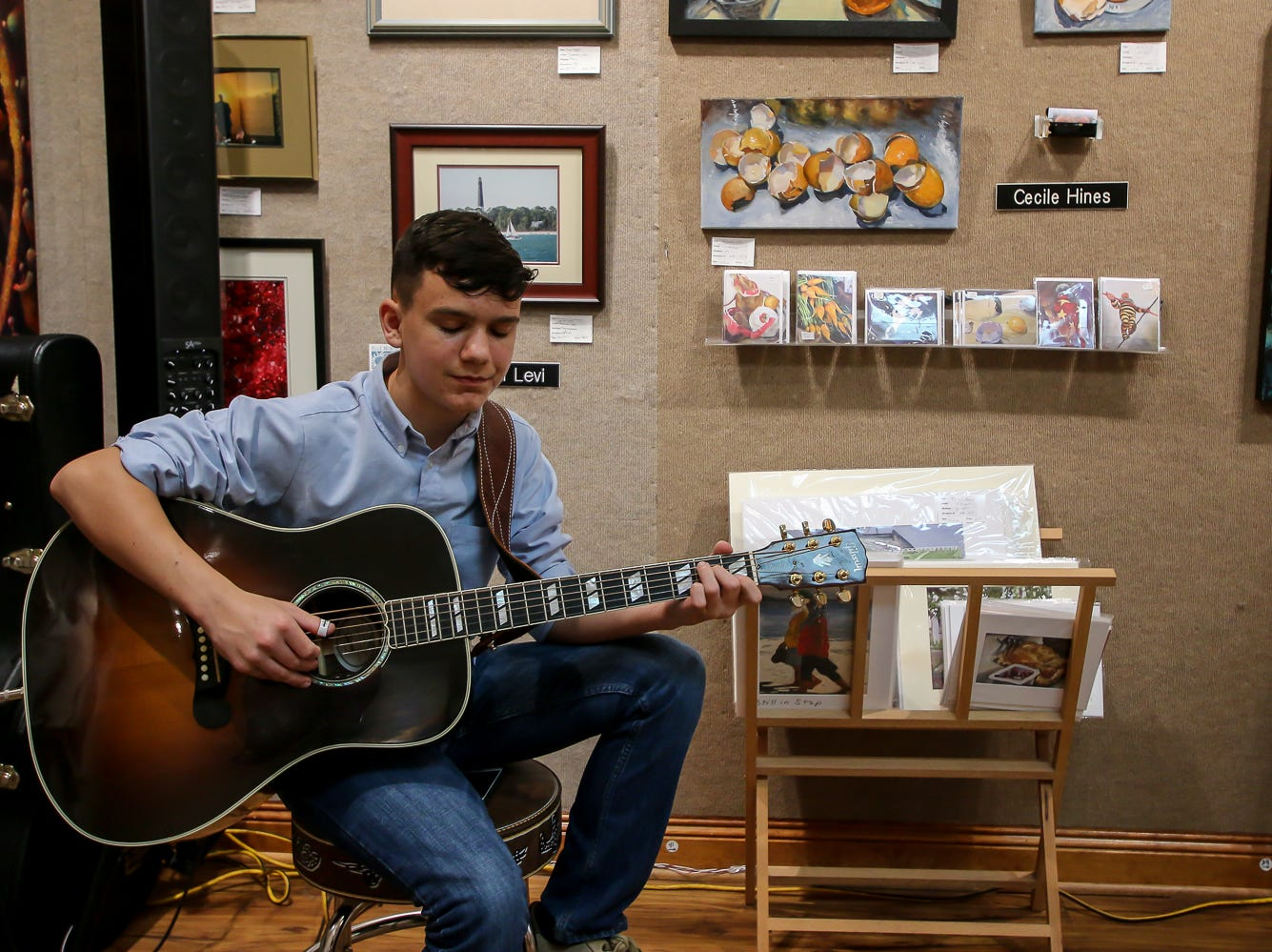 Ben Kennington, 13, performs inside Blue Morning Gallery during Gallery Night on Friday, February 22, 2019.