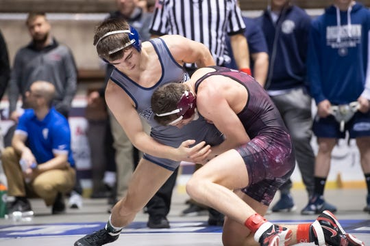 Chambersburg's Tate Nichter, left, wrestles Gettysburg's Luke Sainato during a 145-pound semifinal bout at the District 3 wrestling championships at Hersheypark Arena Saturday, February 23, 2019. Nichter won by decision 9-4.