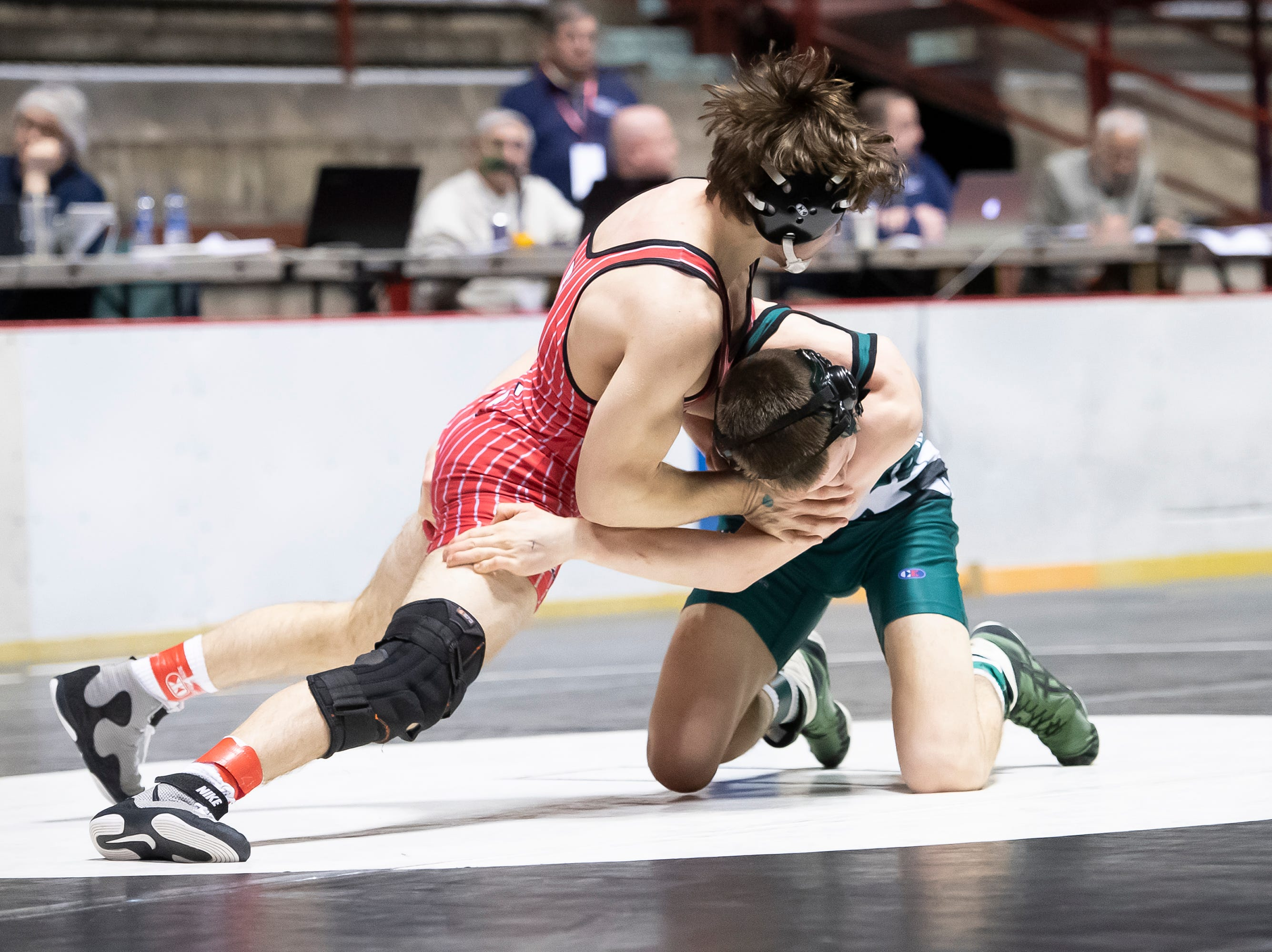 Bermudian Springs' Alijah Wheeler, top, wrestles West Perry's Caden Morrison during a 160-pound semifinal bout at the District 3 wrestling championships at Hersheypark Arena Saturday, February 23, 2019. Morrison won by decision 7-4.