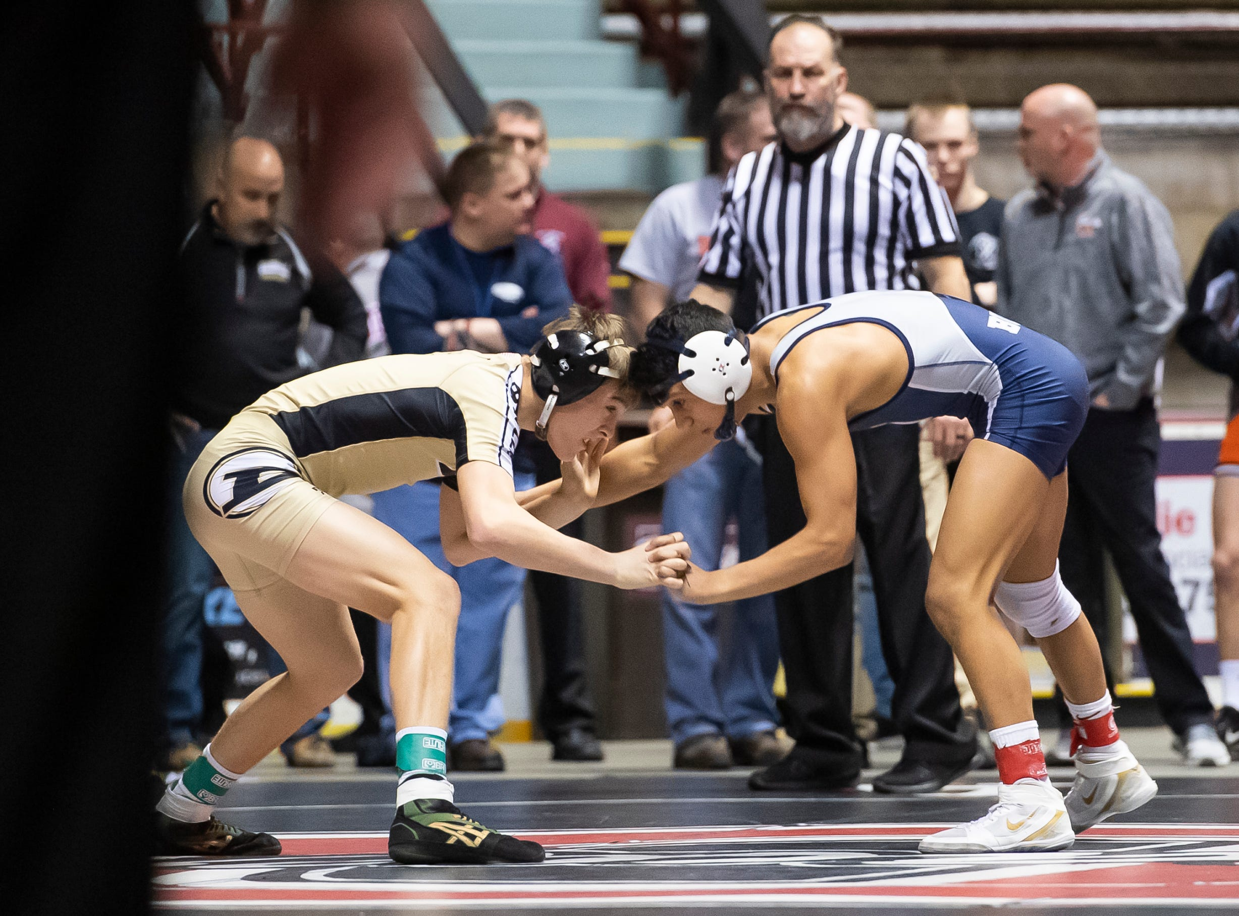 Biglerville's Eli Tuckey, left, wrestles Newport's Dorian Gonzalez during a 132-pound semifinal bout at the District 3 wrestling championships at Hersheypark Arena Saturday, February 23, 2019. Tuckey won by decision 3-2.