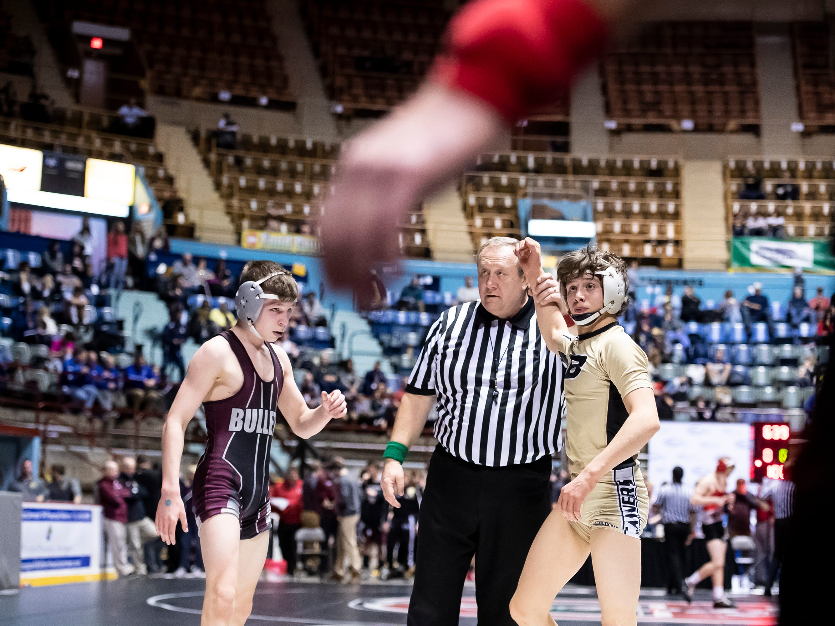 Biglerville's Levi Haines has his hand raised after defeating Brandywine Height's Noah Frack in a 106-pound championship bout at the District 3 wrestling championships at Hersheypark Arena Saturday, February 23, 2019. Haines won by major decision 11-0.