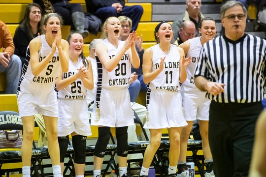 The Delone Catholic bench reacts after Dee McCormick scores late in the fourth quarter against Susquenita in the semifinals of the District 3 3-A playoffs Friday, February 22, 2019. Delone Catholic won 70-35.