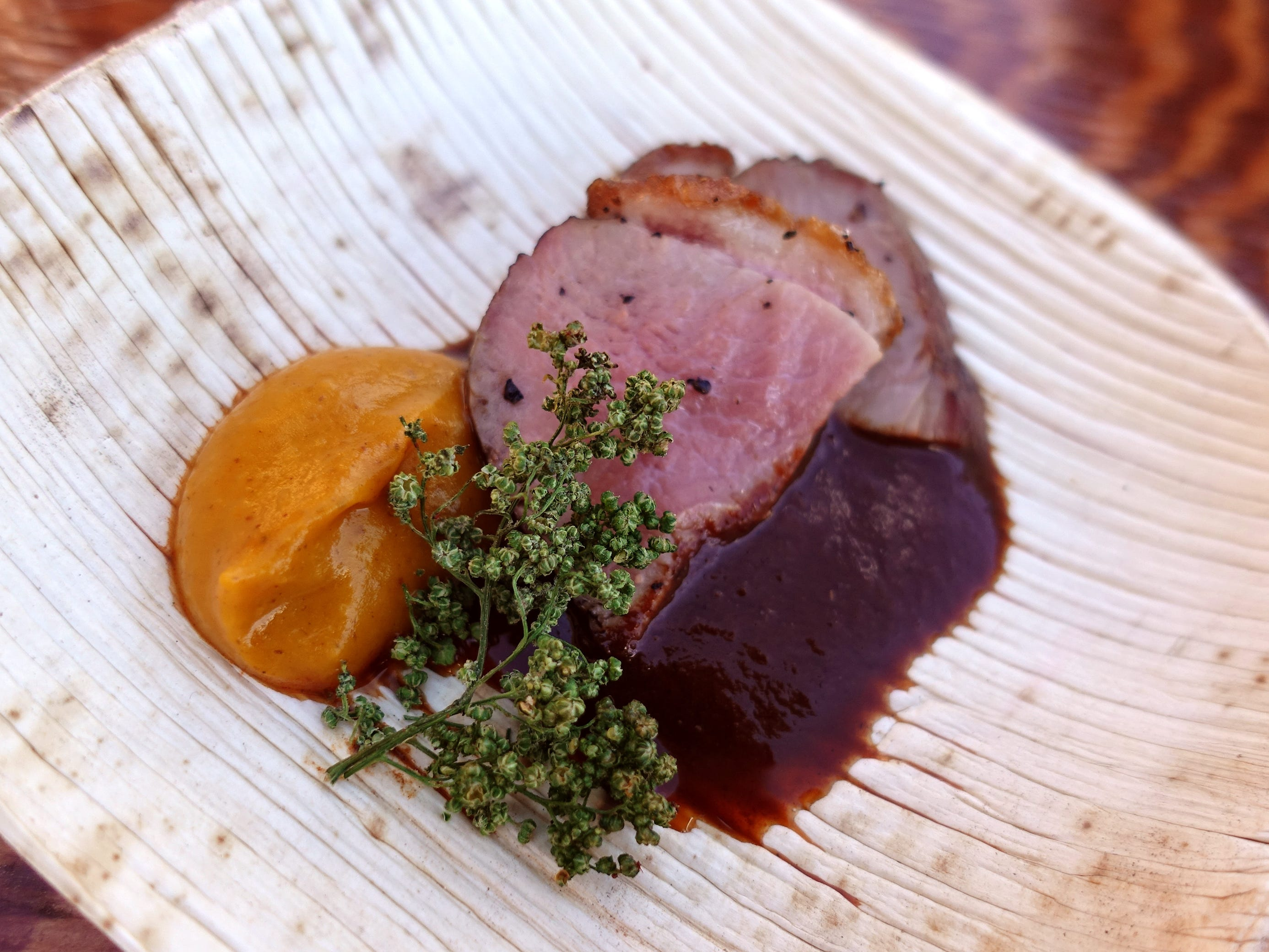 Duck with chicatanas sauce, smoked mole and sweet potato puree from Barrio Cafe Gran Reserva at the 2019 Devour Culinary Classic at the Desert Botanical Garden in Phoenix.
