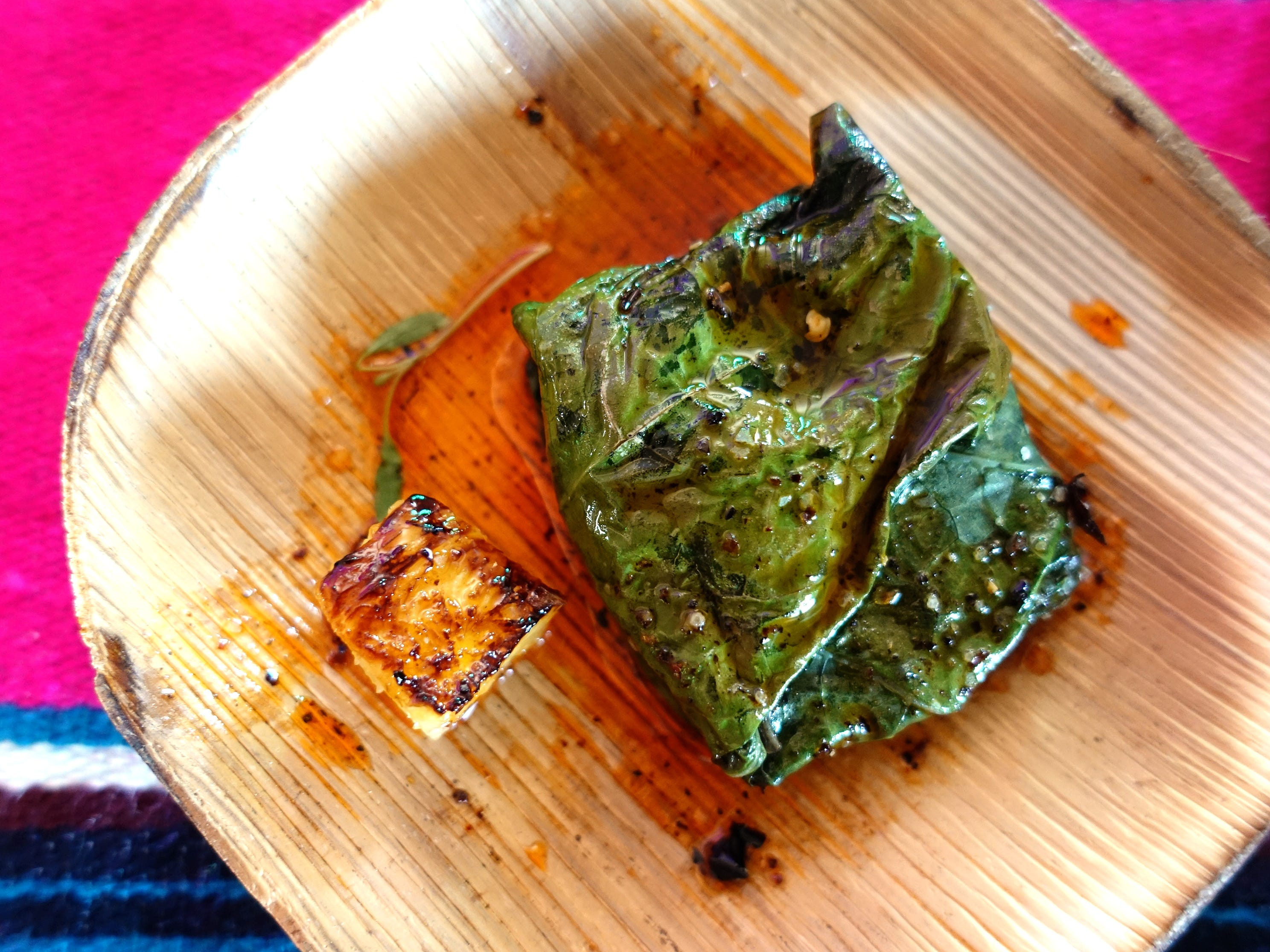 Hoja santa with queso menonita, 14 chile oil and pina asada from Barrio Cafe Gran Reserva at the 2019 Devour Culinary Classic at the Desert Botanical Garden in Phoenix.