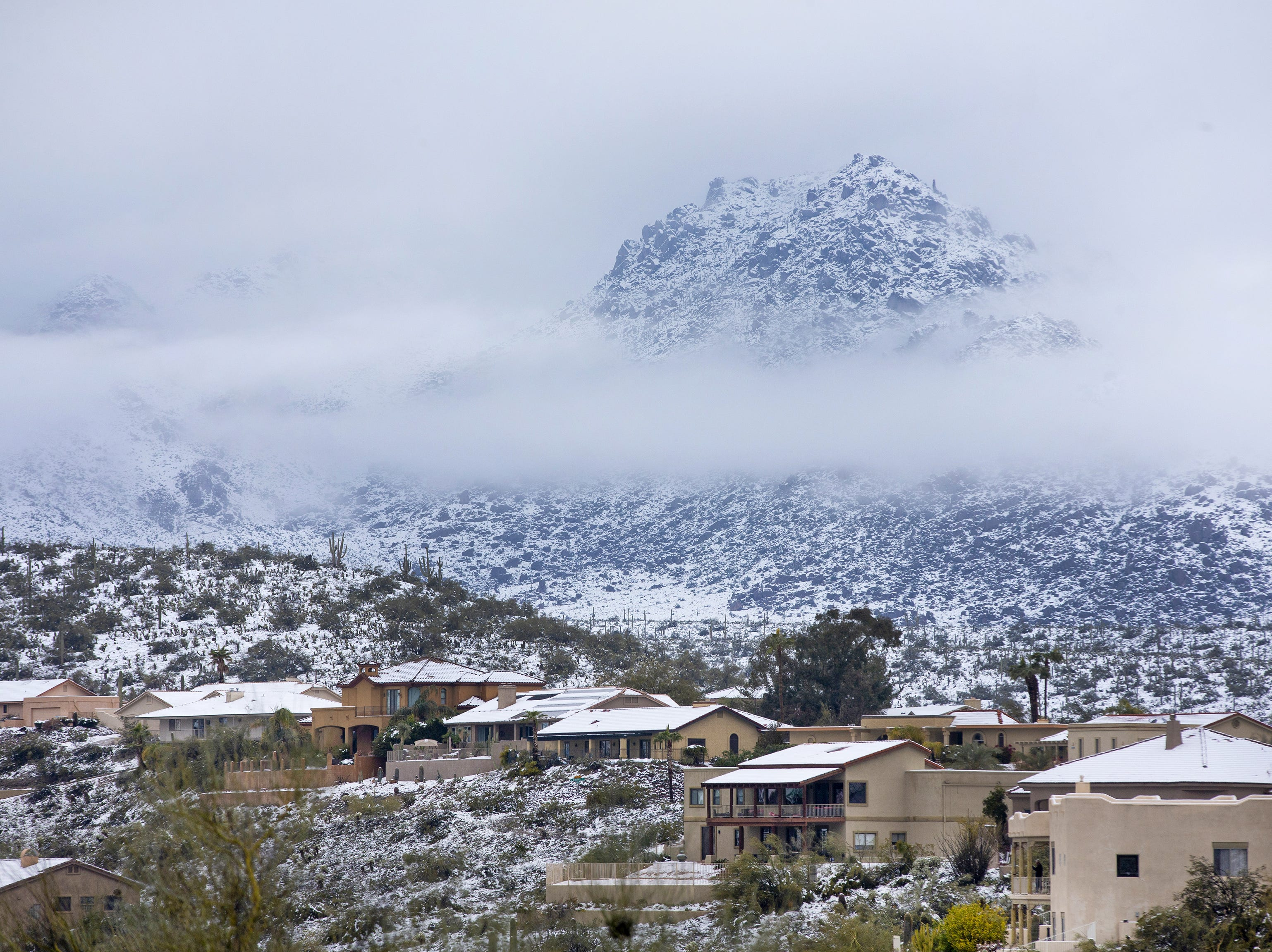 A winter storm covers Fountain Hills in snow.
