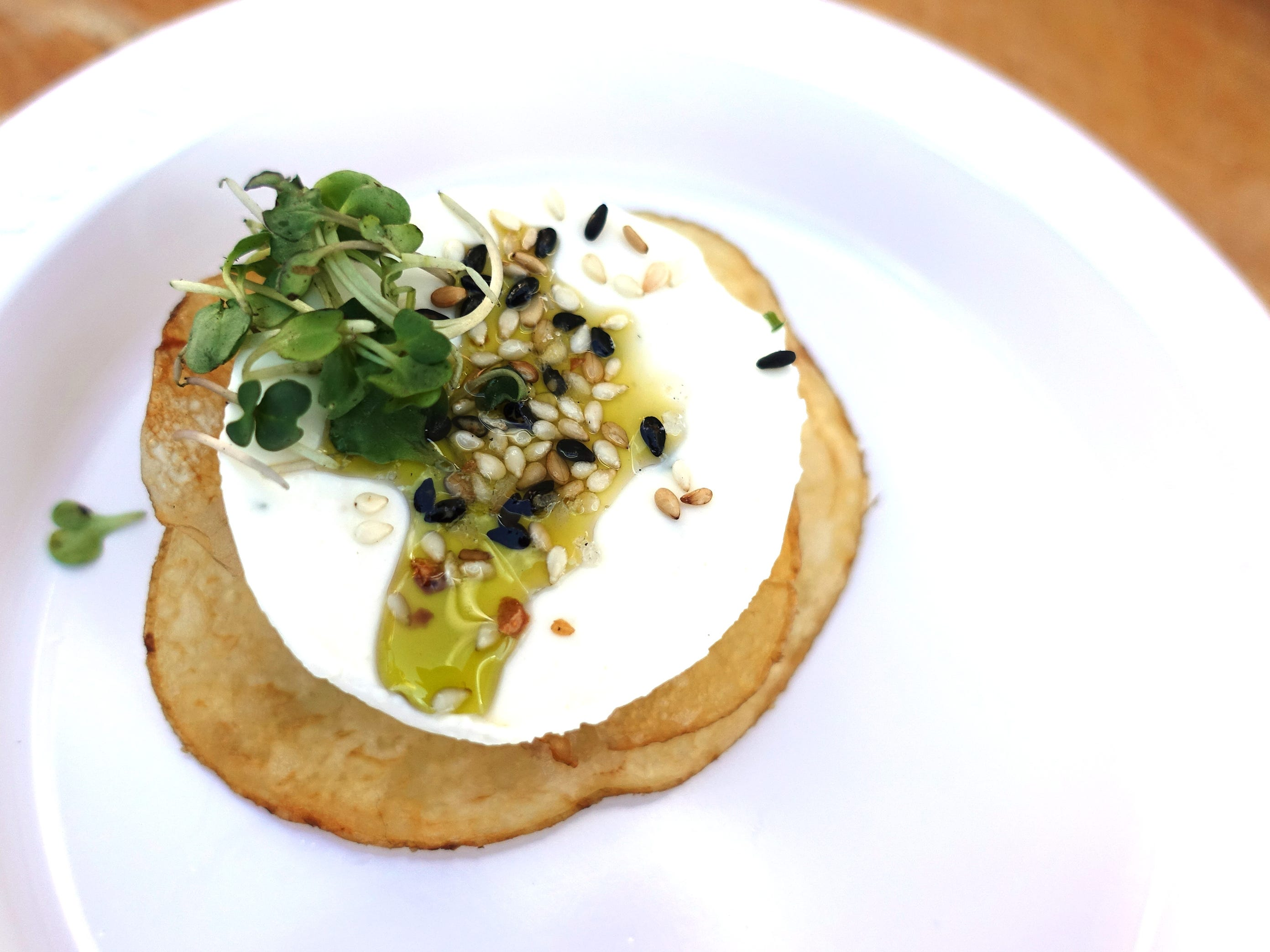 Sour cream and onion panna cotta with Frites Street chip, everything bagel seasoning, chive oil and micro arugula from Stock & Stable at the 2019 Devour Culinary Classic at the Desert Botanical Garden in Phoenix.