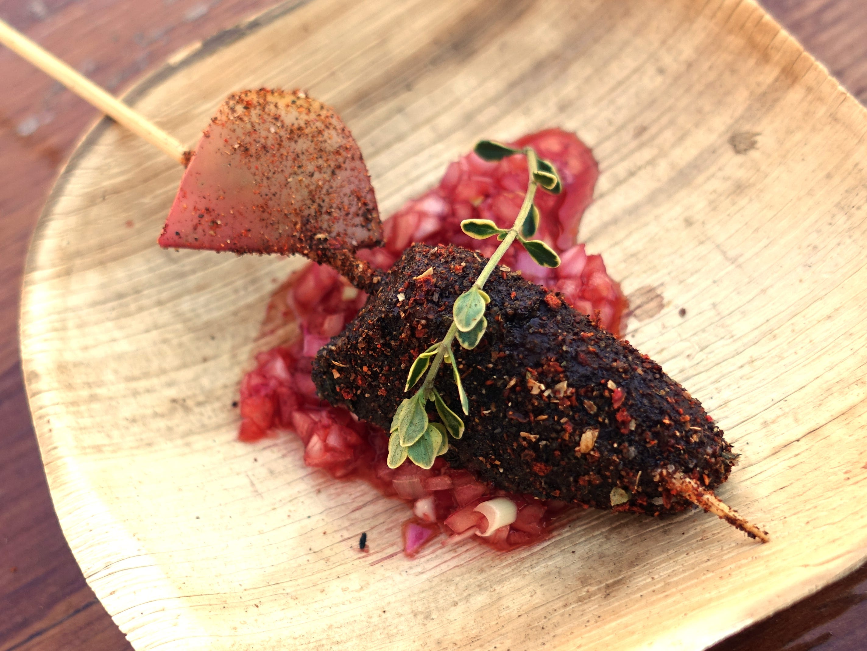 Grilled duck heart with apple, spiced coffee rub and saguaro mignonette from Cotton & Copper at the 2019 Devour Culinary Classic at the Desert Botanical Garden in Phoenix.