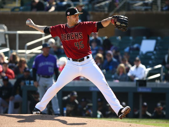 Arizona Diamondbacks pitcher Nick Green throws to the Colorado Rockies in the first inning during a spring training game on Feb. 23, 2019 at Salt River Fields in Scottsdale, Ariz.