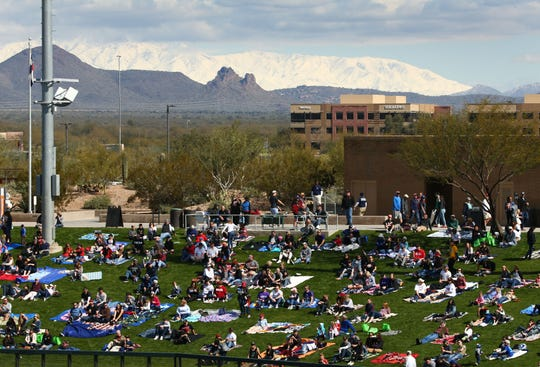 The snow-capped Four Peaks mountain range is seen over right field as the Arizona Diamondbacks play the Colorado Rockies during a spring-training game on Feb. 23, 2019, at Salt River Fields in Scottsdale.