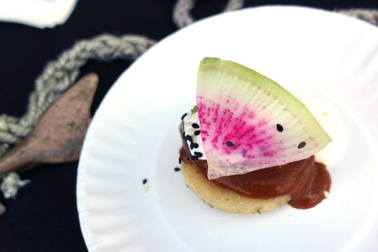 Smoked Chula swordfish belly with masa cake, Oaxaca mole negro, shaved radish, Mexican crema and pickled tomatillo from Chula Seafood at the 2019 Devour Culinary Classic at the Desert Botanical Garden in Phoenix.