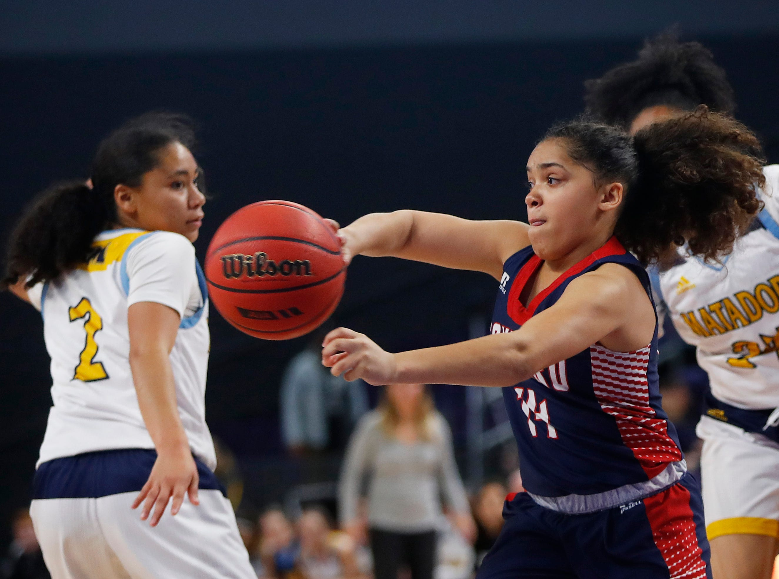 Sahuaro's Hayli Kubly (14) passes after getting past Shadow Mountain's Senya Rabouin (2) during second half of the 4A girls basketball semifinal game at Grand Canyon University Arena in Phoenix, Ariz. on February 22, 2019.