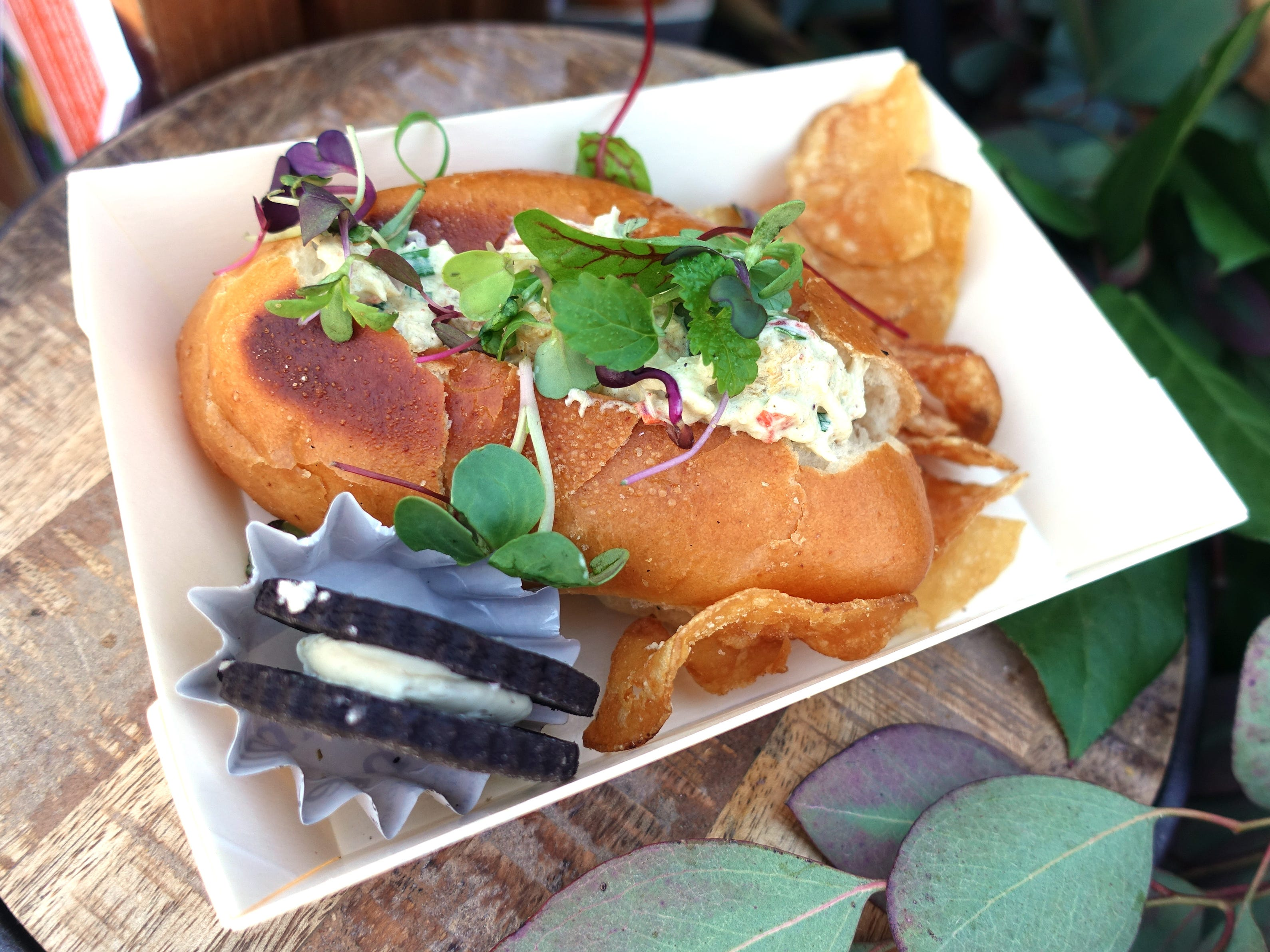 Lobster and shrimp roll with malted chips and lavender oreo cookie from Dust Cutter at the Devour Culinary Classic at the Desert Botanical Garden in Phoenix.