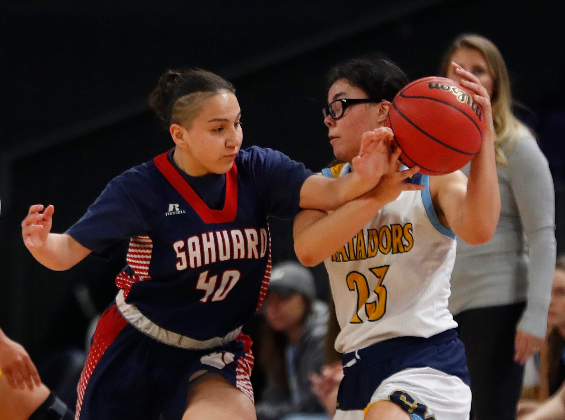 Sahuaro's Milaya Leon (40) knocks loose a ball from Shadow Mountain's Sissy Paloma (23) during second half of the 4A girls basketball semifinal game at Grand Canyon University Arena in Phoenix, Ariz. on February 22, 2019.