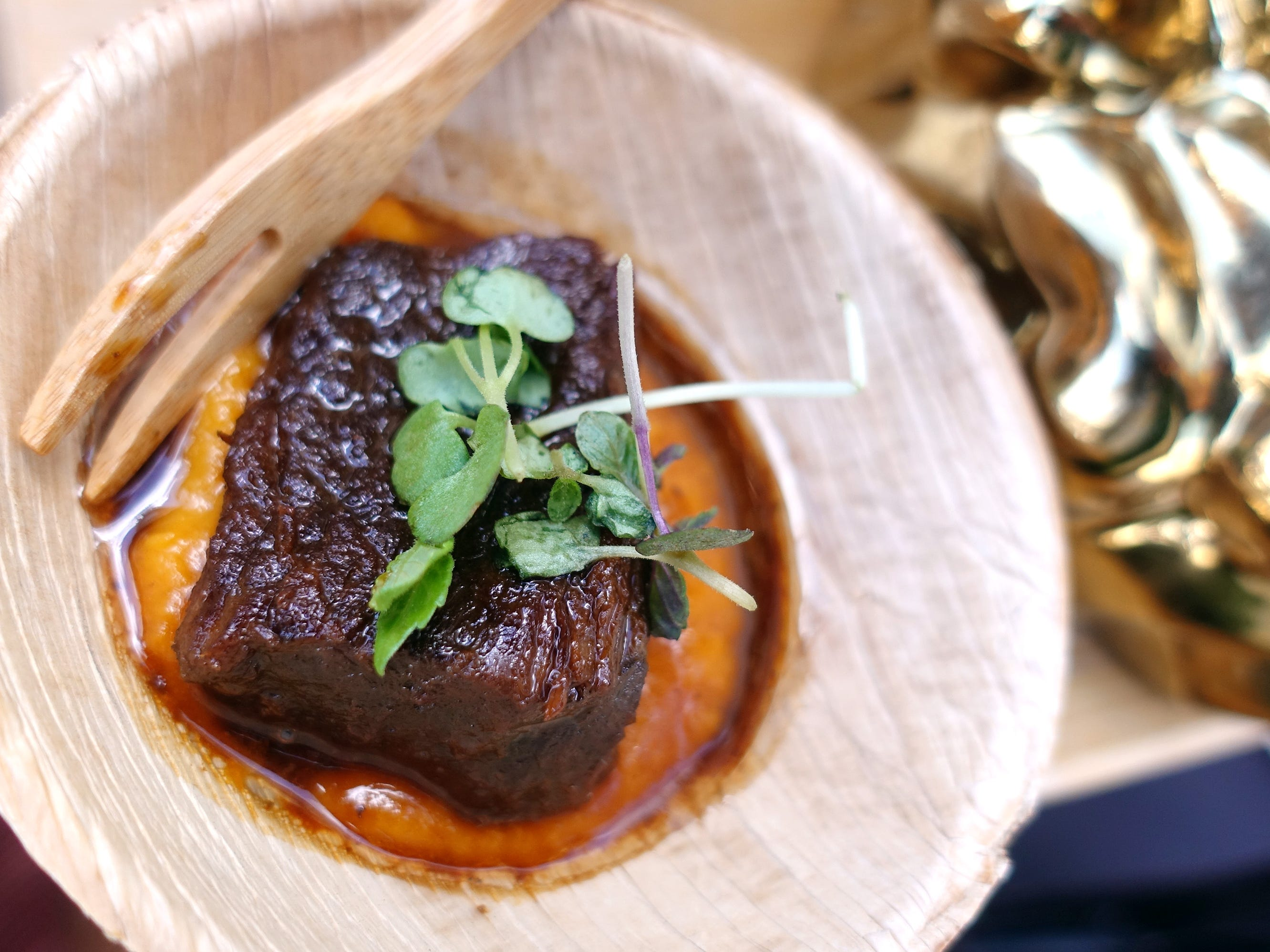 Sweet sake and soy braised short ribs with red garnet potato, shiso and brussels sprouts from Sushi Roku at the 2019 Devour Culinary Classic at the Desert Botanical Garden in Phoenix.