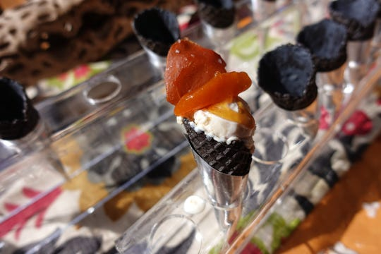 Jamon Iberico de bellota ice cream with Marcona almond, kumquat, jamon sprinkles, PX sherry caramel and squid ink cone from Talavera at the 2019 Devour Culinary Classic at the Desert Botanical Garden in Phoenix.