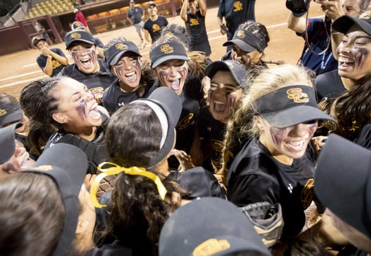 The Salpointe Catholic Lancers celebrate their 2-0 win against the Cactus Cobras in the 4A Softball State Championships at Farrington Softball Stadium on Tuesday, May 15, 2018 in Tempe, Arizona.