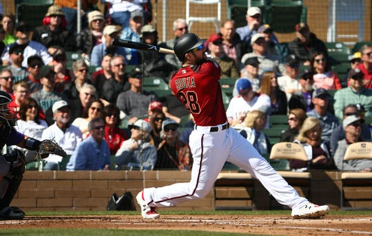 Arizona Diamondbacks Steven Souza Jr. hits a three-run home run off Colorado Rockies pitcher Chad Bettis in the first inning during a spring training game on Feb. 23, 2019 at Salt River Fields in Scottsdale, Ariz.