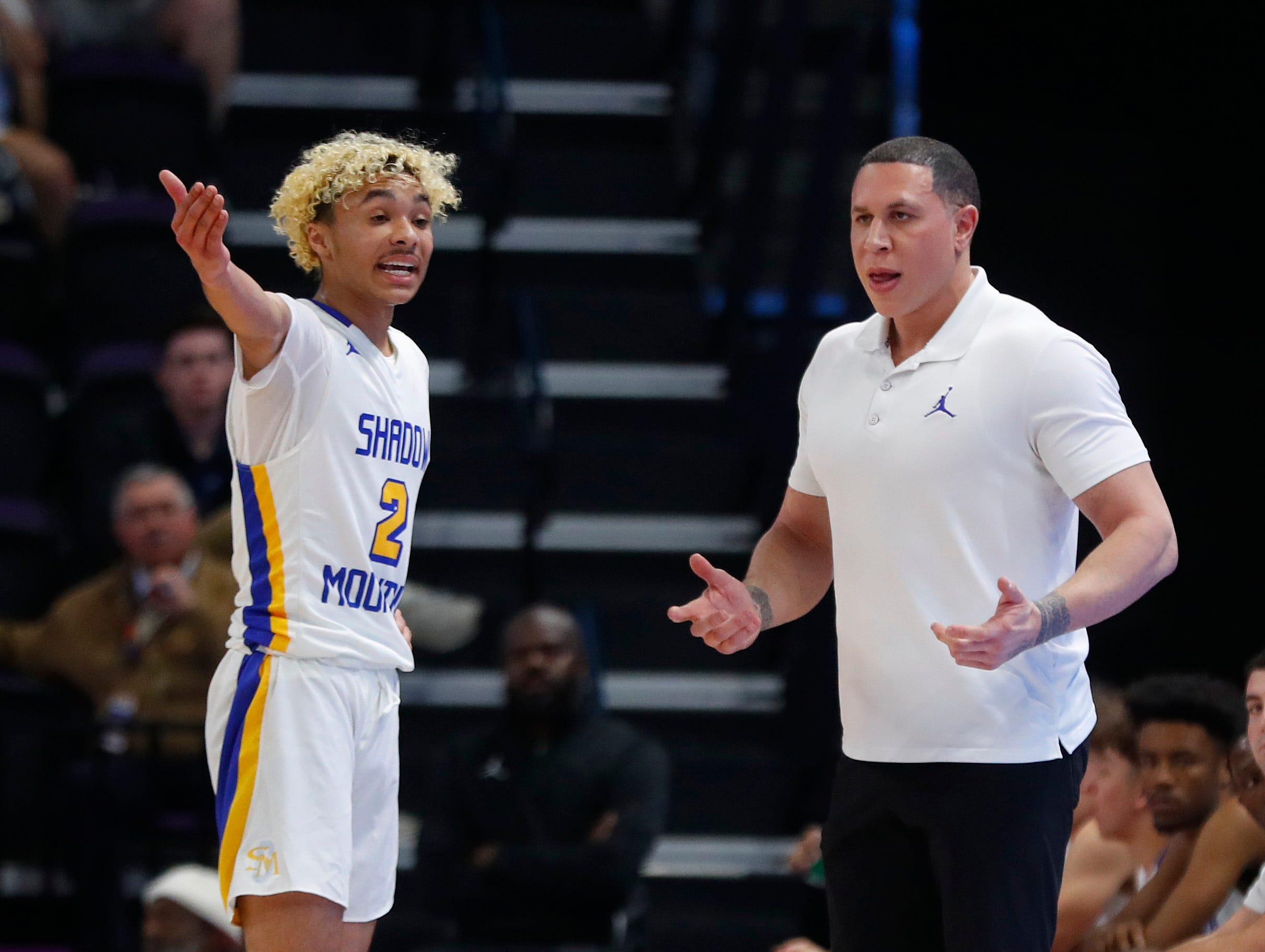 Shadow Mountain's head coach Mike Bibby talks with Jaelen House (2) during first half of the 4A boys basketball semifinal game against Salpointe Catholic at Grand Canyon University Arena in Phoenix, Ariz. on February 22, 2019.