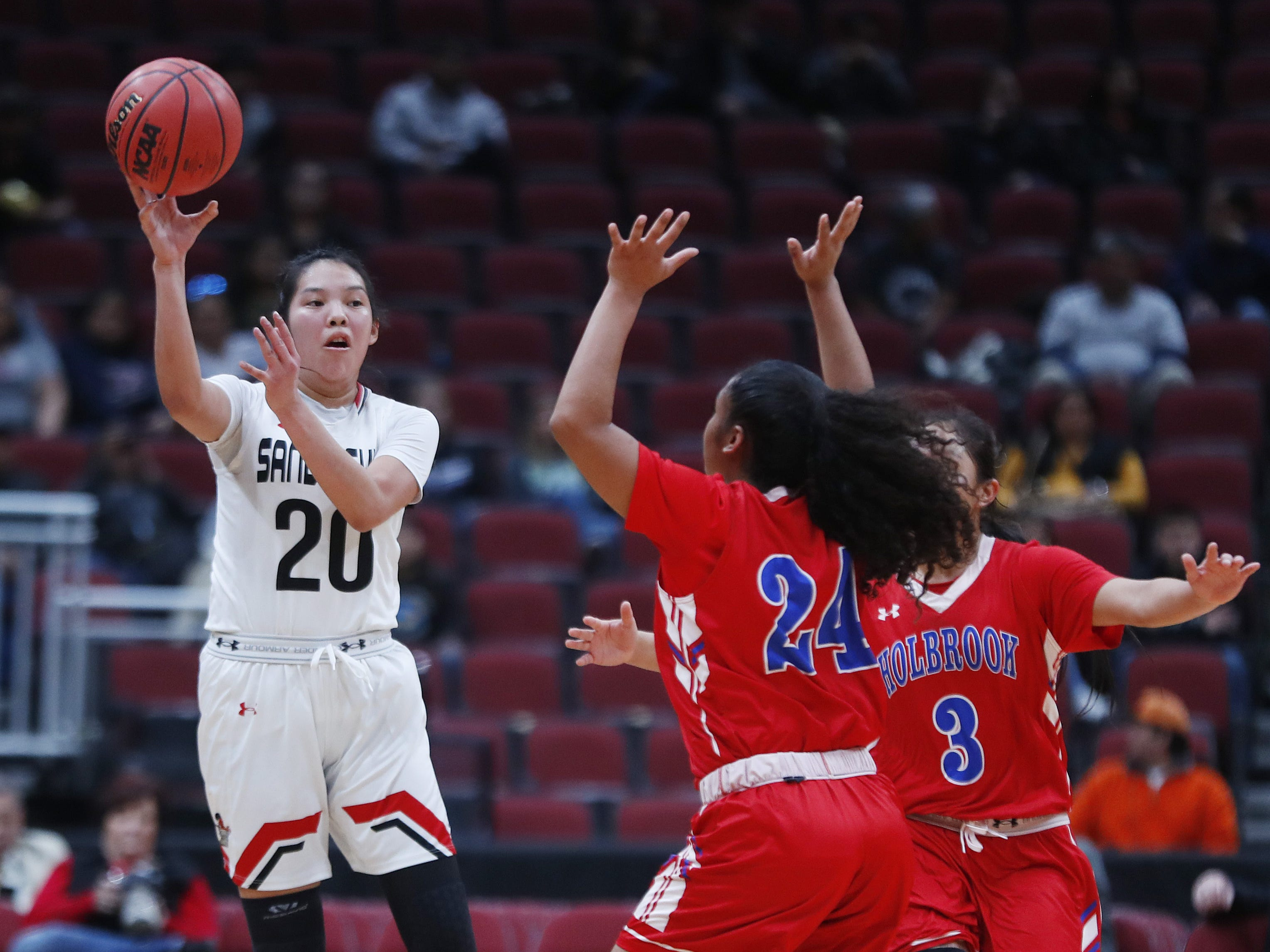Page's Myka Taliman (20) passes under defensive pressure from Holbrook's Madison Chappell (24) during the first half of the 3A girls basketball state championship at Gila River Arena in Glendale, Ariz. on February 23, 2019.