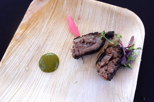 Smoked Wagyu brisket with i'itoi onion emulsion and pickled radish from Roka Akor at the Devour Culinary Classic at the Desert Botanical Garden in Phoenix.