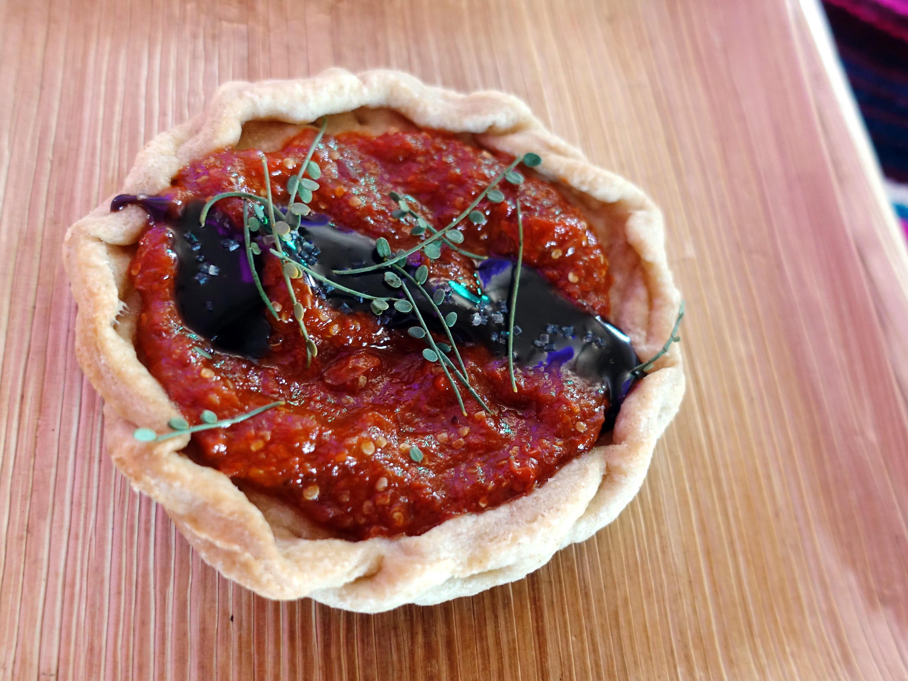Wolfberry tart with Pima wheat crust, mesquite chocolate and palo verde from Cotton & Copper at the 2019 Devour Culinary Classic at the Desert Botanical Garden in Phoenix.