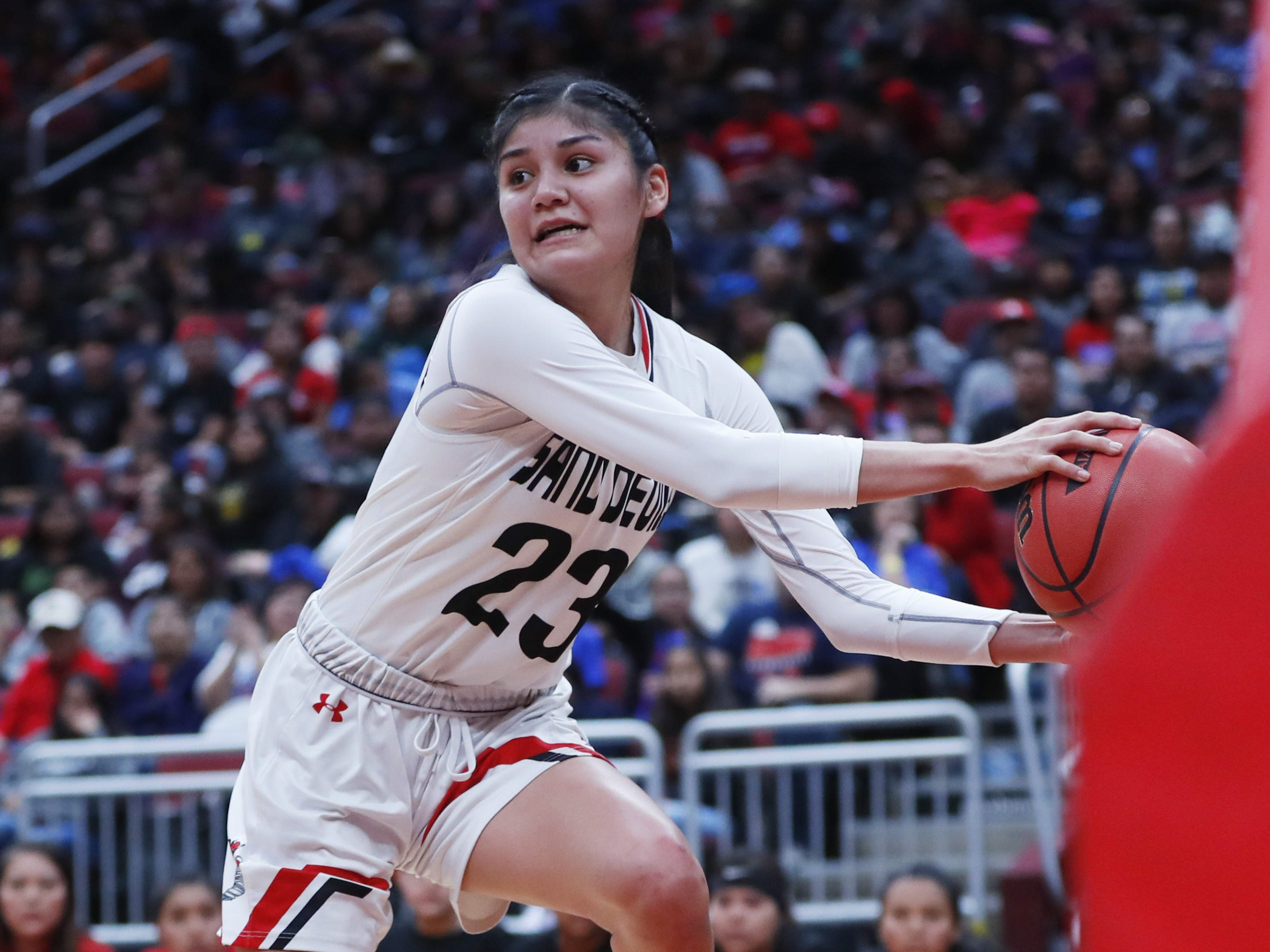 Page's Camryn Nockideneh (23) grabs a ball and saves it from out of bounds during the first half of the 3A girls basketball state championship game against Holbrook at Gila River Arena in Glendale, Ariz. on February 23, 2019.