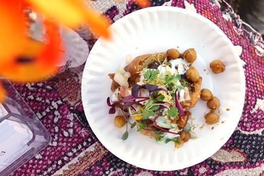 Samosa chaat with potato, green peas, tamarind, mint, yogurt, onion and chickpeas from Marigold Maison at the Devour Culinary Classic at the Desert Botanical Garden in Phoenix.