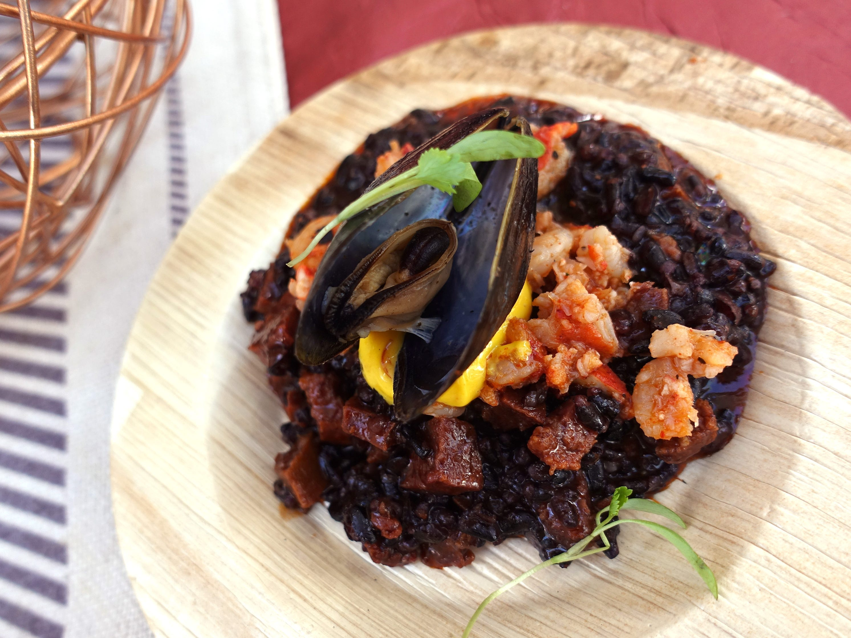Arroz negro with forbidden rice, Maine lobster, bay shrimp, calamari, mussel, chorizo and saffron aioli from T. Cook's at the Devour Culinary Classic at the Desert Botanical Garden in Phoenix.