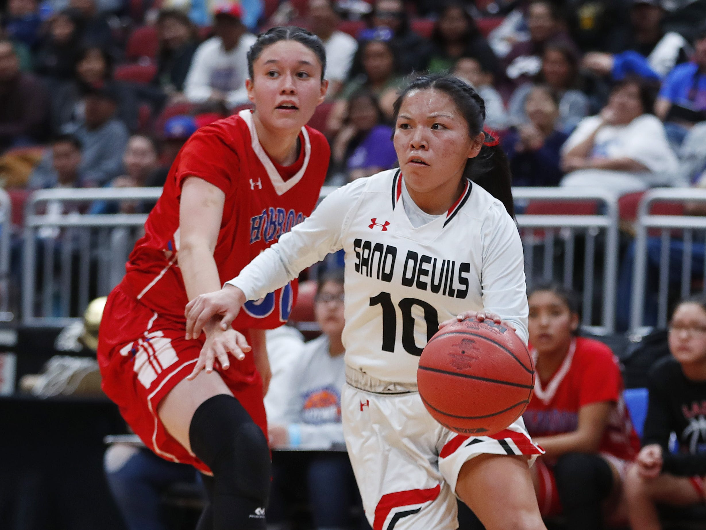 Page's Mikala Benally (10) drives past Holbrook's Matehya Aberle (50) during the first half of the 3A girls basketball state championship at Gila River Arena in Glendale, Ariz. on February 23, 2019.