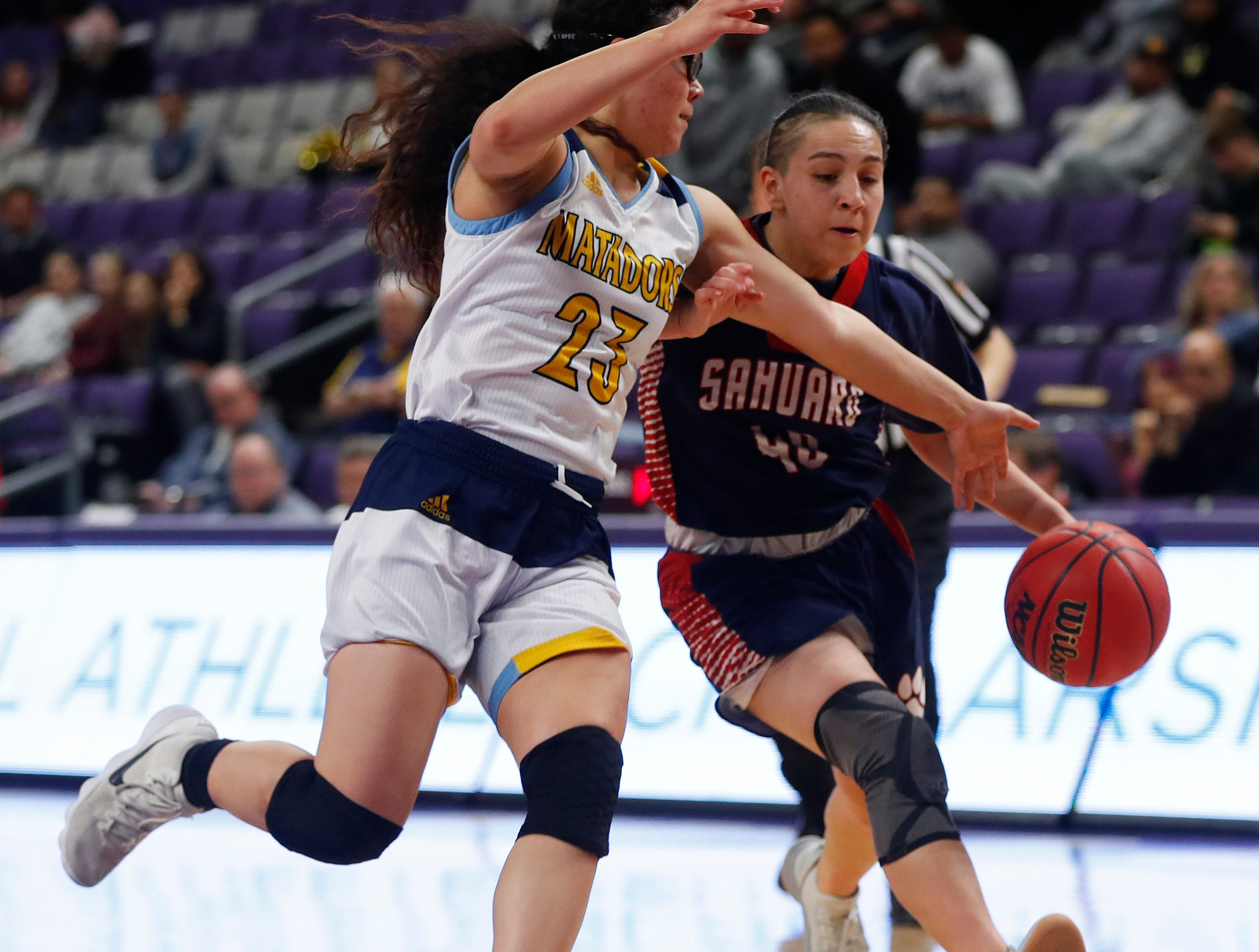 Sahuaro's Milaya Leon (40) drives to the basket against Shadow Mountain's Sissy Paloma (23) during second half of the 4A girls basketball semifinal game at Grand Canyon University Arena in Phoenix, Ariz. on February 22, 2019.