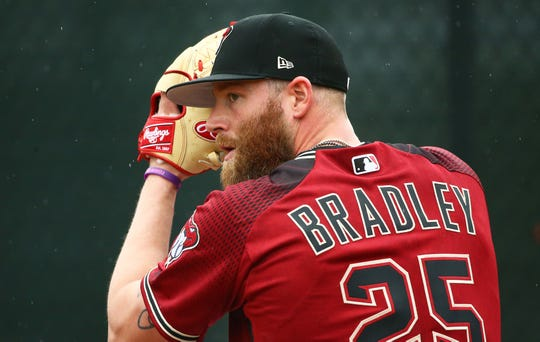 Diamondbacks pitcher Archie Bradley gets set to pitch during a spring training workout on Feb. 14 at Salt River Fields.