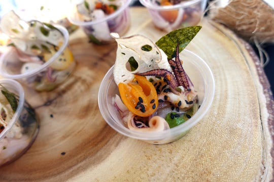 Seven kingdoms ceviche with Atlantic squid, lime and yuzu ponzu, cherry tomato, red onion, cilantro, lotus root chip and nori from Muse & Market at the 2019 Devour Culinary Classic at the Desert Botanical Garden in Phoenix.