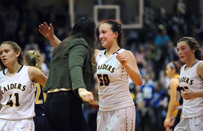 Elco's Ryelle Shuey gets a hug from head coach Ashli Shay after she put in a lay-up to put her team in front of Eastern York 44-42.