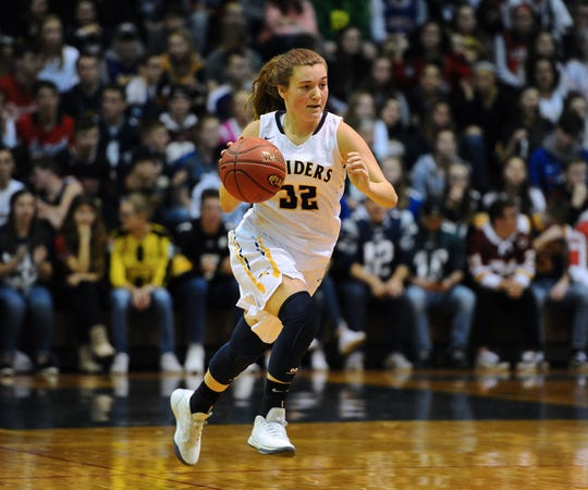 Elco's Amanda Smith (32) brings the ball upcourt during the second half of action.
