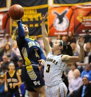 Eastern York's Cassidy Arnold (3) shoots over Elco's Katelyn Rueppel (3) during the first half of action.