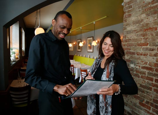 Laura Pinsiero owner of Gigi Trattoria in Rhinebeck talks with her general manager, Jean-Luc Ahouangonou about the weekend's specials on Feb 22, 2019.