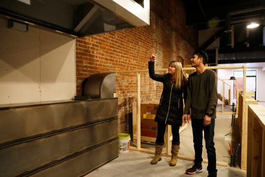 From left, Katherine Dhurandhar and business parter Prachit Shah of Bombay Wraps discuss the location of their ventilation hood at the Hudson Valley Food Hall in Beacon on February 20, 2019. Bombay Wraps will feature Indian fast food including kati rolls.